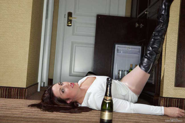 Thigh boots Thursday Miss Hybrid cracks open the bubbly and rips her pantyhose.